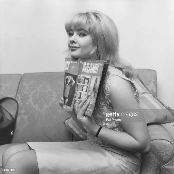 Welsh model showgirl and witness in the Profumo scandal Mandy RiceDavies at her Kensington home with a copy of her book 'The Mandy Report'