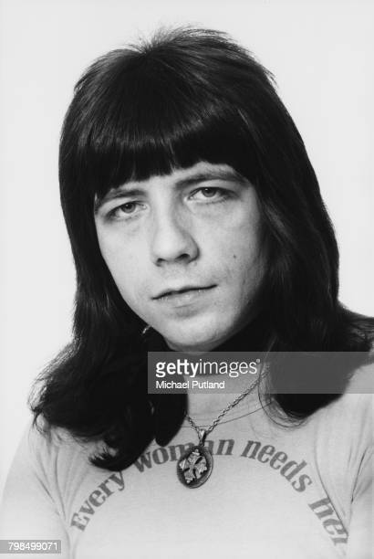 Welsh musician and guitarist Andy Scott of British glam rock group The Sweet posed in England in April 1975