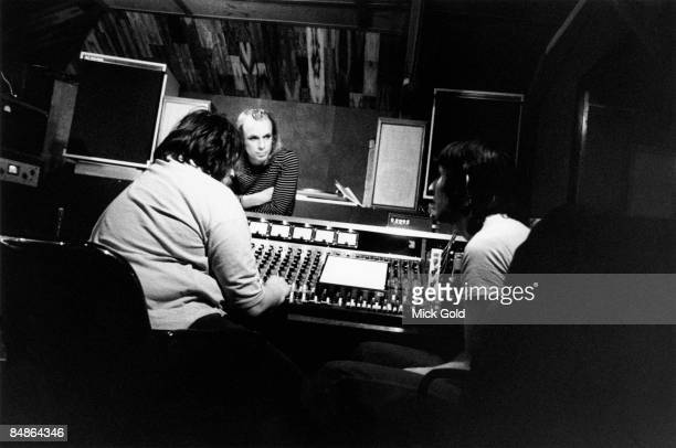 Photo of John WOOD and John CALE and Brian ENO with John Cale and engineer John Wood at mixing desk in studio recording Fear