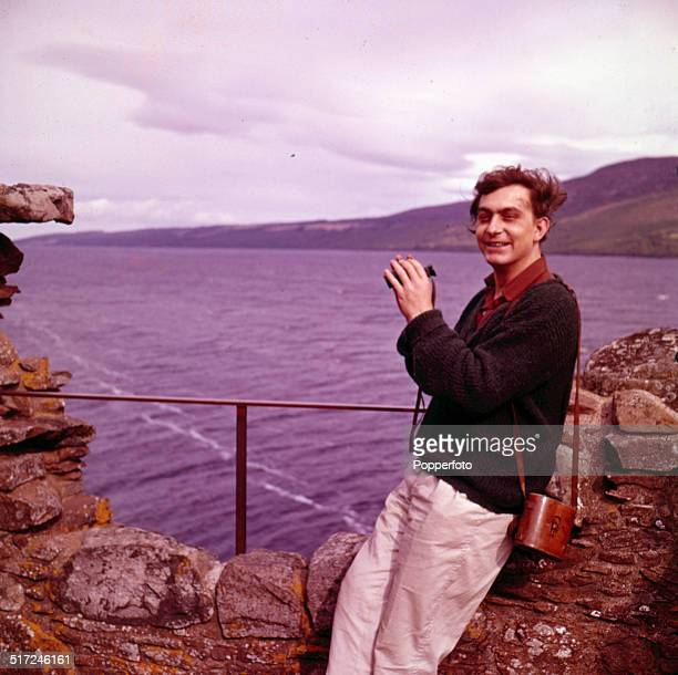 Welsh novelist Bill Hopkins pictured on the shore of Loch Ness in Scotland in 1964
