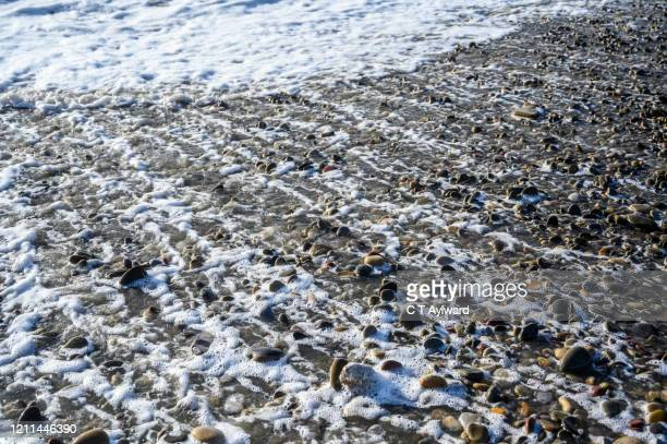 welsh pebble beach and waves - porthcawl stock pictures, royalty-free photos & images