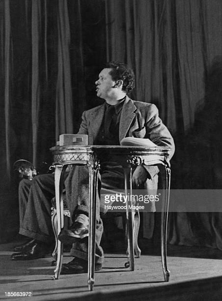 Welsh poet Dylan Thomas acting as stage manager at a one-night performance of Pablo Picasso's play 'Desire Caught By The Tail' at the Rudolf Steiner...