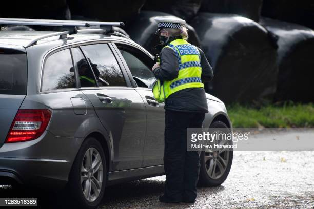 Welsh police pull over motorists at a police checkpoint on the A477 between Carmarthenshire and Pembrokeshire during Wales' 'firebreak' lockdown...