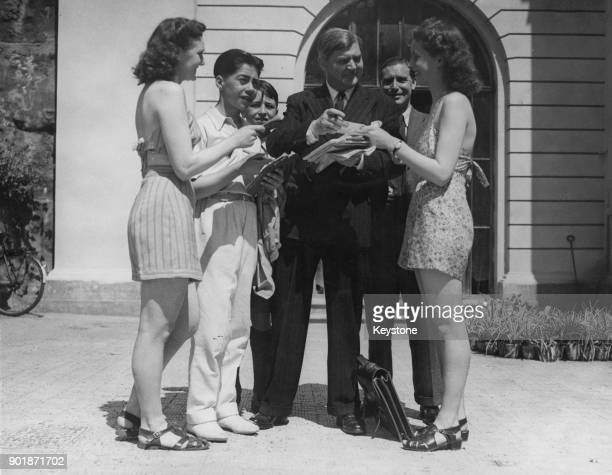 Welsh politician Aneurin Bevan the Minister of Health signs autographs for fans during the last day of the Labour Party Conference in Margate UK 31st...