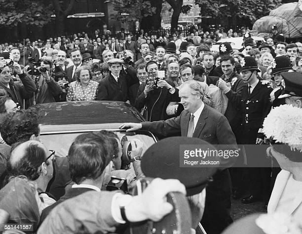 Welsh politician Gwynfor Evans, President of Plaid Cymru, greeted by crowds of press and supporters after winning his Carmarthen seat from the Labour...