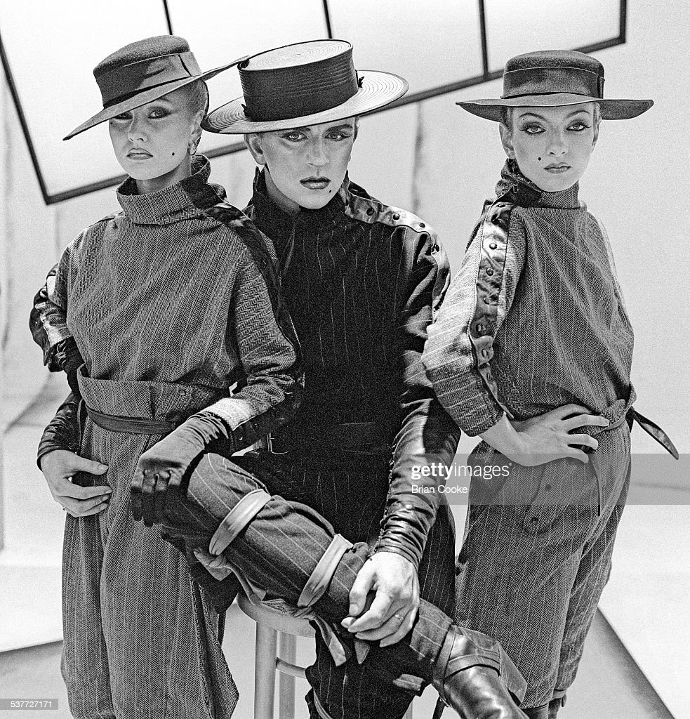 Welsh pop singer Steve Strange (1959 - 2015, centre), of British new romantic group, Visage, with two models at a photo shoot in St John's Wood in North London, 8th July 1981.