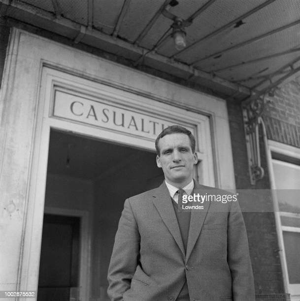 Welsh proofessional footballer and captain of Peterborough United, Vic Crowe pictured leaving hospital after recovering from injury on 9th March 1965.