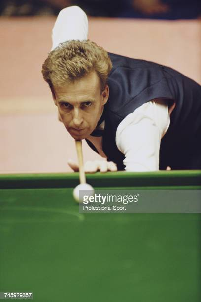 Welsh professional snooker player Terry Griffiths pictured in action during competition in the 1990 Embassy World Snooker Championship at the...
