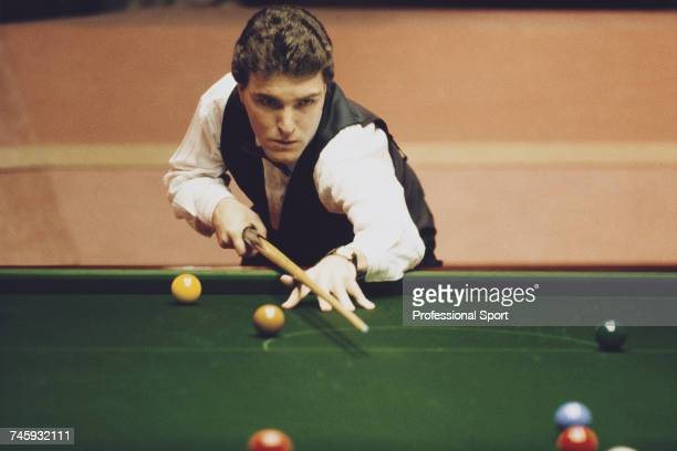Welsh professional snooker player Wayne Jones pictured in action during competition in the 1989 Embassy World Snooker Championship at the Crucible...