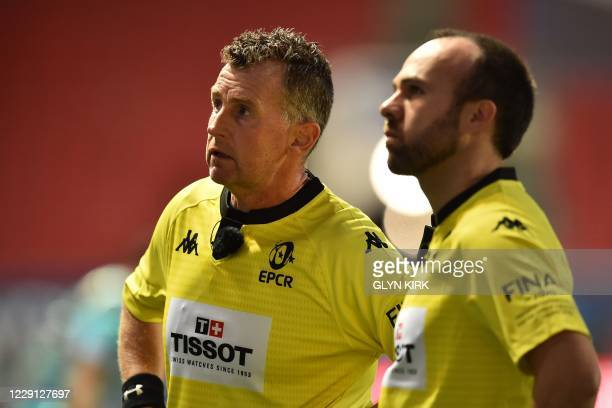 Welsh referee Nigel Owens checks a replay during the European Rugby Champions Cup final rugby union match between Exeter Chiefs and Racing 92 at...