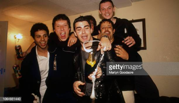 Welsh rock group Stereophonics backstage with friends at Manchester Apollo 1999 Stuart Cable second left Kelly Jones front centre Richard Jones back...