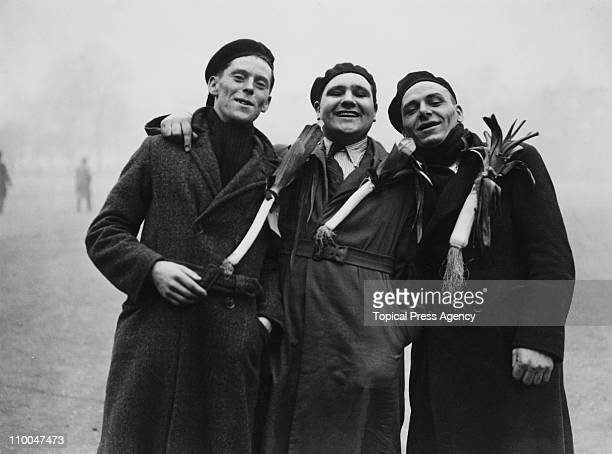 Welsh rugby fans holding leeks on Horse Guards Parade London the morning before an international against England at Twickenham 19th January 1935