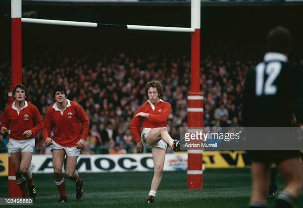 Welsh rugby full back JPR Williams takes a kick during the Centenary Test against New Zealand at Cardiff Wales 1st November 1980 On the left are...