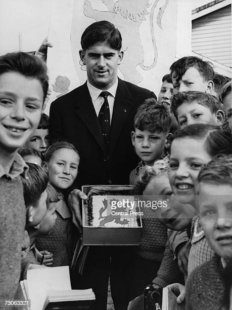 Welsh rugby international Malcolm Thomas meets a group of schoolchildren in New Zealand 21st August 1959 On Thomas' right is nineyearold Malcolm...