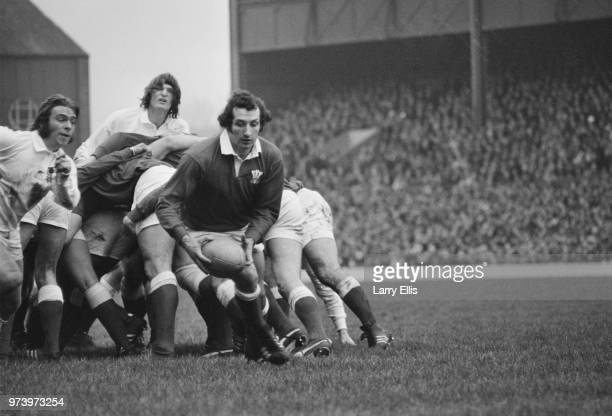 Welsh rugby player and scrum half for the Wales national rugby union team Gareth Edwards pictured with the ball during the 1972 Five Nations...