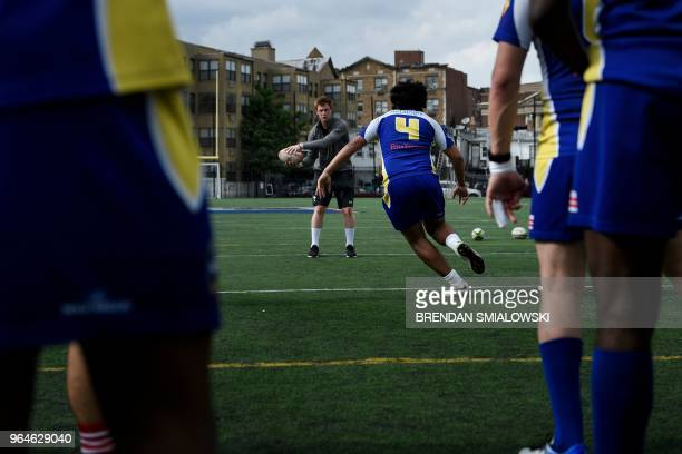 Welsh Rugby Union player Rhys Patchell participates in a workshop for youth rugby players at the Columbia Heights Education Campus on May 31 2018 in...