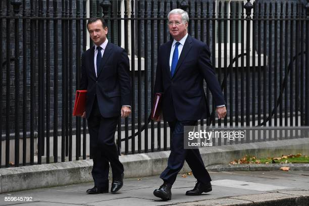 Welsh Secretary Alun Cairns and Defence Secretary Michael Fallon arrive in Downing Street ahead of a Cabinet meeting on October 10 2017 in London...