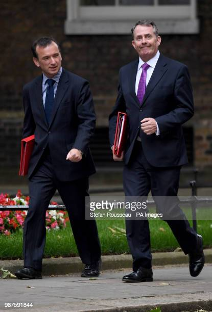 Welsh Secretary Alun Cairns and Secretary of State for International Trade Liam Fox arrive in Downing Street London for a cabinet meeting