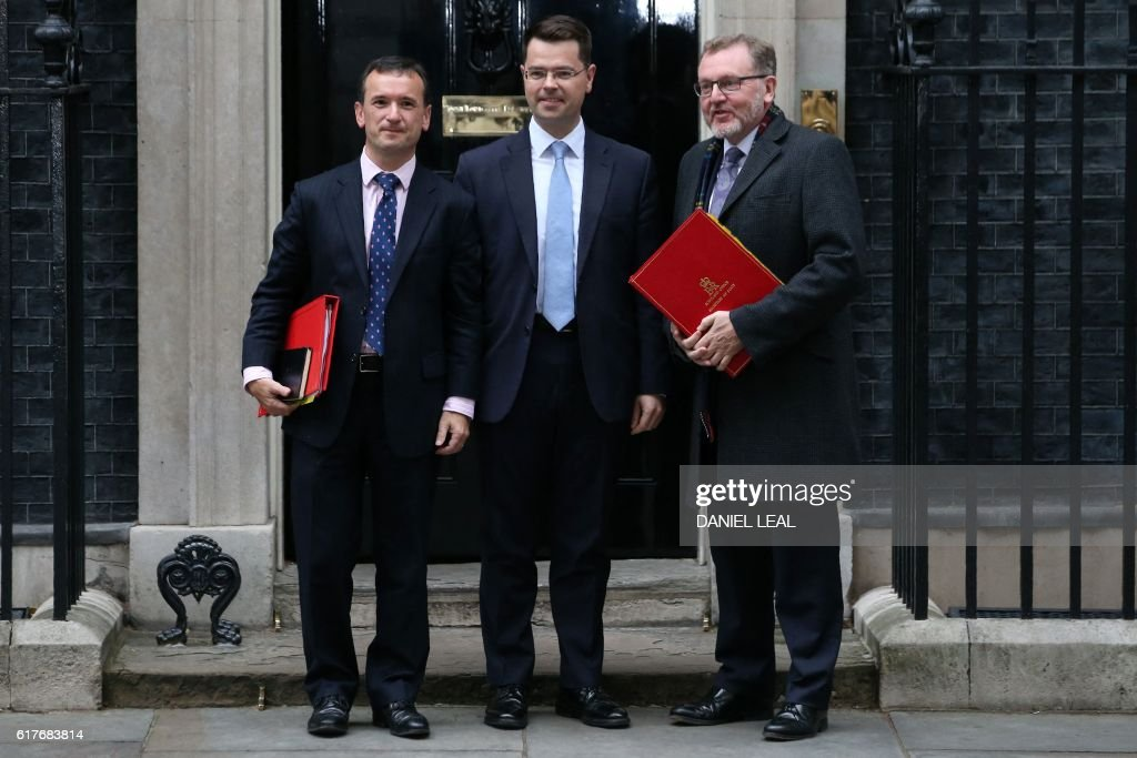 Welsh Secretary Alun Cairns (L), Secretary of State for Northern Ireland, James Brokenshire (C) and David Mundell, Secretary of State for Scotland pose for a photograph outside 10 Downing Street in central London on October 24, 2016 after taking part in talks with British Prime Minister Theresa May and the first ministers of Northern Ireland, Wales and Scotland on the government's Brexit plans. / AFP / DANIEL