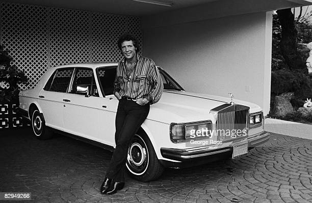 Welsh singer and popular Las Vegas musical act Tom Jones poses with his Rolls Royce during a 1987 Los Angeles California photo portrait session