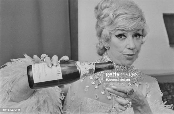Welsh singer Dorothy Squires celebrates with an Italian sparkling wine, UK, 11th July 1974.