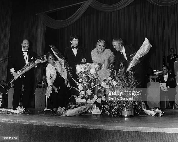 Welsh singer Dorothy Squires is showered with bouquets at the end of a sellout performance at the London Palladium 6th December 1970
