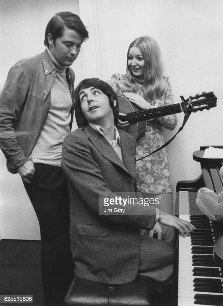 Welsh singer Mary Hopkin goes over a new song with Pete Brady and Paul McCartney of the Beatles while preparing for an appearance on Brady's Thames...