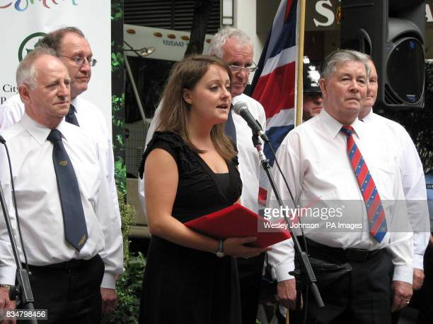 Welsh singer Rebecca Jenkins sings 'Let it Be' with the Comrades Male Voice Choir from Wales at a concert in the British Memorial Garden in Hanover...