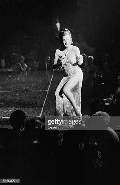 Welsh singer Shirley Bassey performs on stage at 'The Talk of the Town' nightclub London 1967