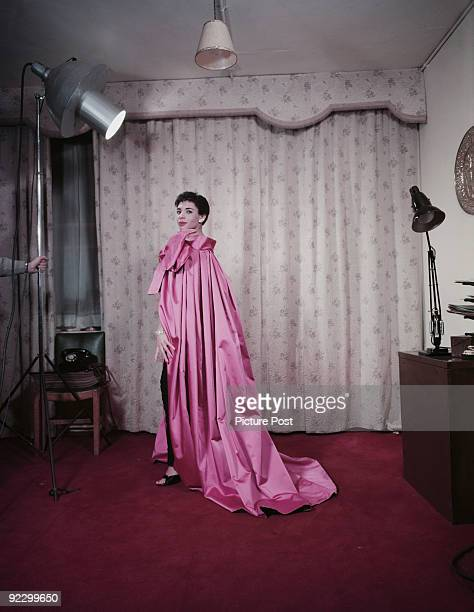 Welsh singer Shirley Bassey poses in a photographer's studio wearing a fulllength mauve cape November 1956 Original publication Picture Post Cover...