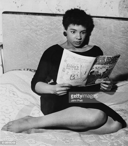 Welsh singer Shirley Bassey reading a 'TrueToLife Romances' comic book at her family home in Tiger Bay Cardiff Wales 1955