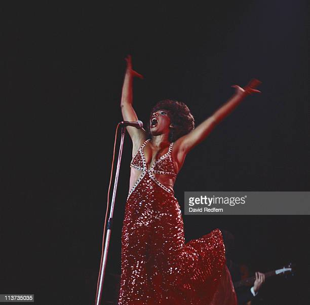 Shirley Bassey British singer singing on stage during a live concert performance in Bournemouth England Great Britain in October 1974 Bassey stands...