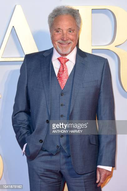 Welsh singer Sir Tom Jones poses on the red carpet upon arrival for the UK premiere of the film A Star is Born in central London on September 27 2018