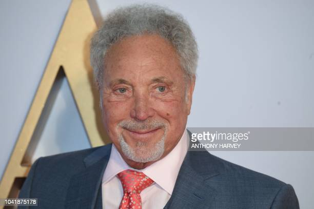 Welsh singer Sir Tom Jones poses on the red carpet upon arrival for the UK premiere of the film 'A Star is Born' in central London on September 27...