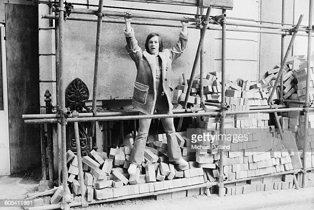 Welsh singer songwriter and guitarist Andy Fairweather Low at a construction site in London 30th December 1975