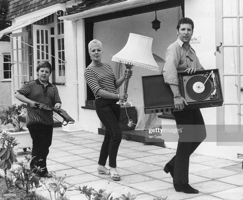 Welsh singer Tom Jones and his family, wife Linda and son Mark, moving into their new home Sunbury in Surrey, 21st July 1967.