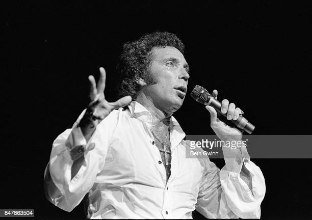 Welsh singer Tom Jones holds up a large pair of underpants while performing at the Grand Ole Opry on September 5 1985 in Nashville Tennessee