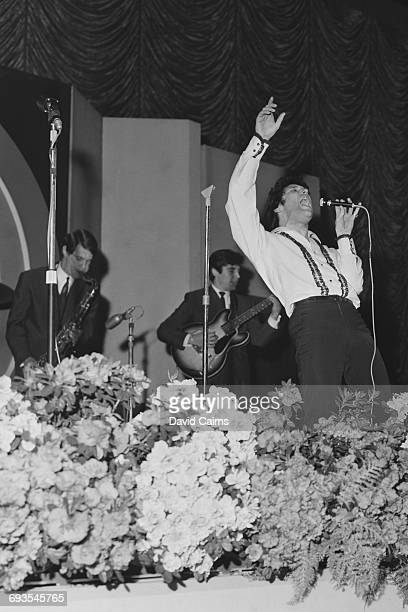 Welsh singer Tom Jones performs at the Daily Express Record Show UK 21st March 1965