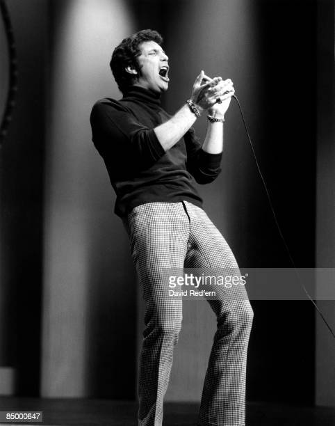 Welsh singer Tom Jones performs live on stage in London circa 1965.