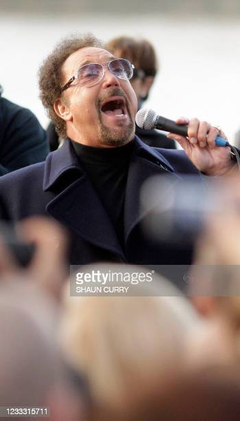 Welsh singer Tom Jones performs on London's South Bank, on November 19 and raises money in aid of a cancer charity. AFP PHOTO/Shaun Curry