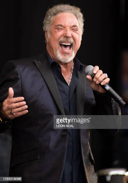 Welsh singer Tom Jones performs on the Pyramid Stage on the third day of the annual Glastonbury festival near Glastonbury, Somerset on June 28, 2009....