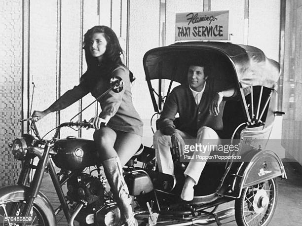 Welsh singer Tom Jones pictured sitting in the back of a motorcycle taxi service driven by Sherrie Sehcahz as he arrives at the Flamingo Hotel in Las...
