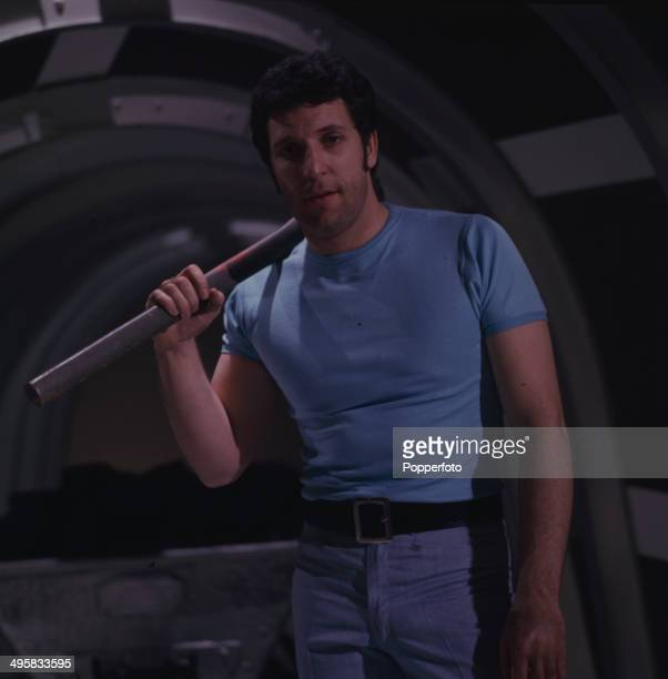Welsh singer Tom Jones posed holding a pickaxe on the set of his television series 'The Tom Jones Show' in 1967