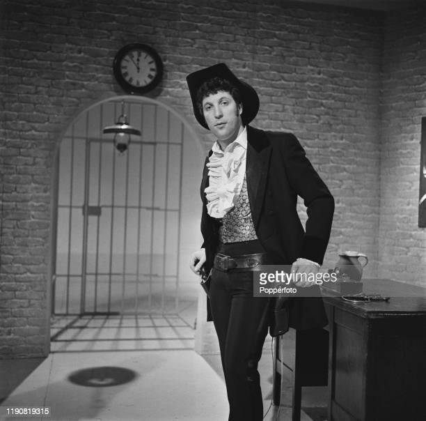 Welsh singer Tom Jones posed on set dressed in western gear during filming of the Associated Television series 'Tom Jones' in April 1967
