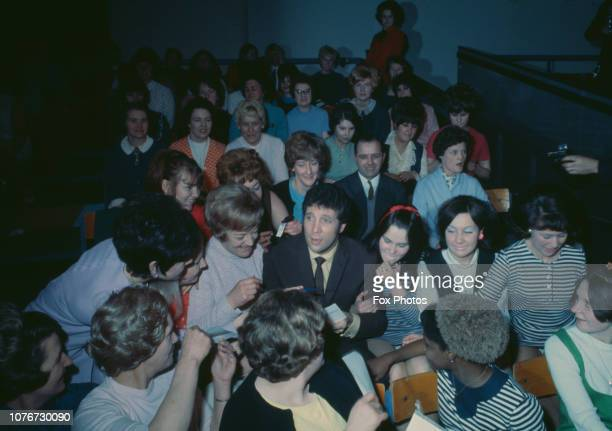 Welsh singer Tom Jones surrounded by female fans during a preview of ATV variety series 'This Is Tom Jones' 1969