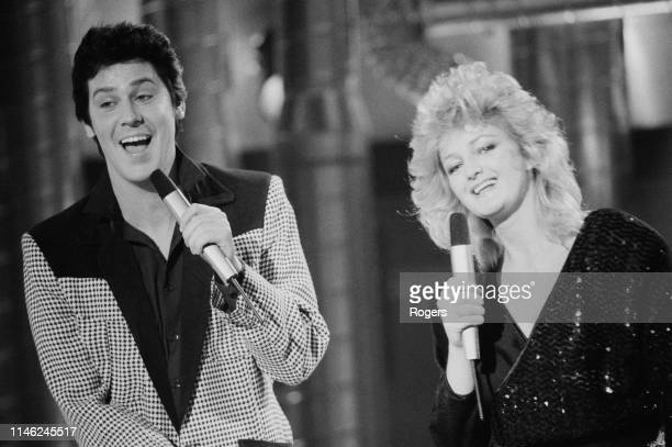 Welsh singers Shakin' Stevens and Bonnie Tyler performing at the Channel 4 Christmas Show UK 12th December 1983