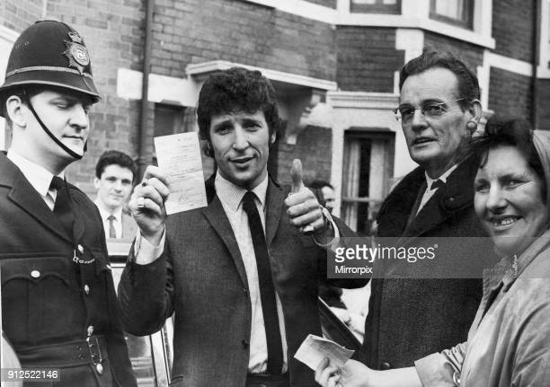 Welsh singing star Tom Jones shows his certificate after passing his driving test in Newport today March 1966