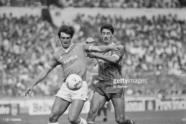 Welsh soccer player Kevin Ratcliffe of Everton FC in action against Ian Rush of Liverpool FC during the FA Charity Shield match at Wembley Stadium,...