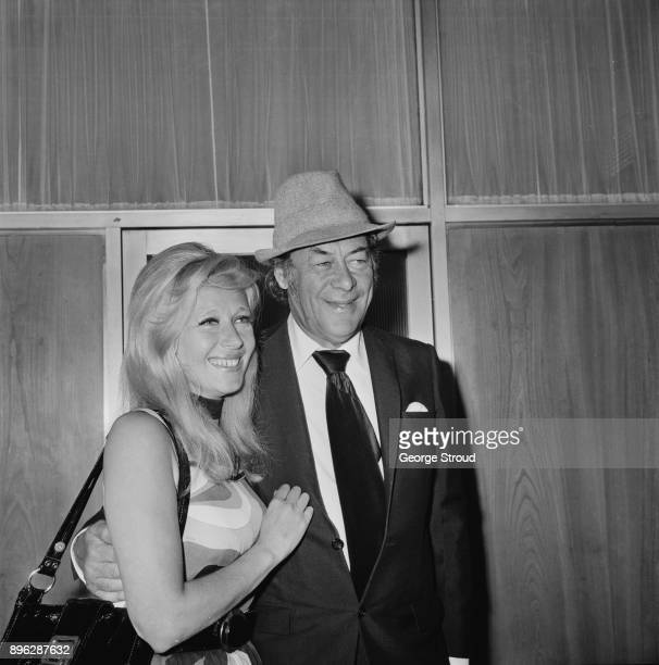 Welsh socialite Elizabeth ReesWilliams and British actor Rex Harrison at Heathrow AirportLondon UK 20th August 1971