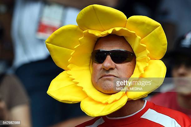 Welsh supporter is pictured ahead of the Euro 2016 round of sixteen football match Wales vs Northern Ireland, on June 25, 2016 at the Parc des...
